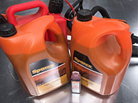 A photo of some chainsaw lubricants